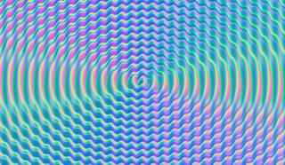трехмерный график, что-то вроде z=sin(x)+sin(sqrt(x^2+y^2))